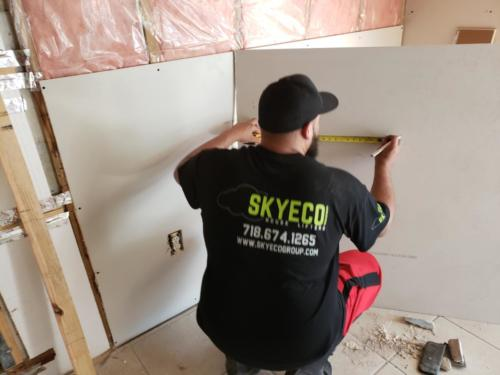 worker with drywall image
