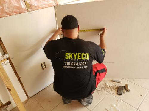 worker with drywall