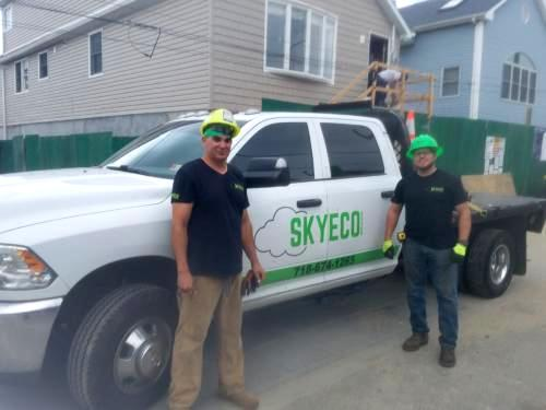 Workers with Skyeco company truck